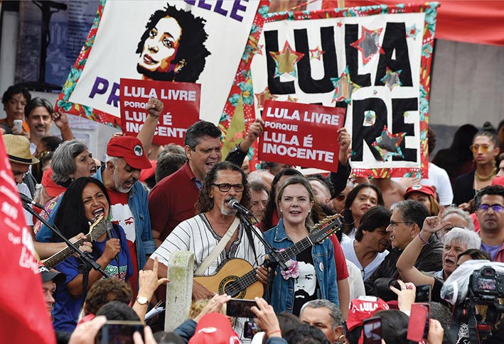 Workers' Party President Gleisi Hoffmann (<em>center right</em>) attends a demonstration 7 April 2019—the anniversary of the incarceration of former Brazilian President Luiz Inácio Lula da Silva—outside the jail where Lula is being held in Curitiba, Brazil.