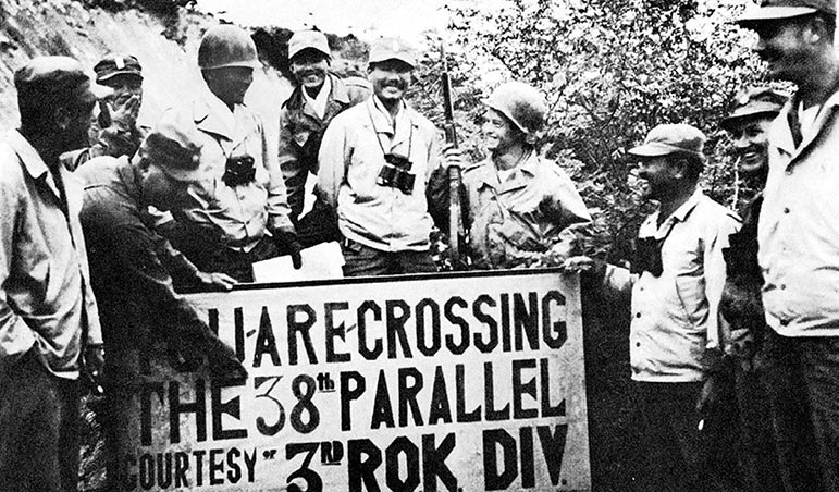 Members of a UN public health and welfare detachment, a composite allied force, meet at a crossing point on the 38th parallel