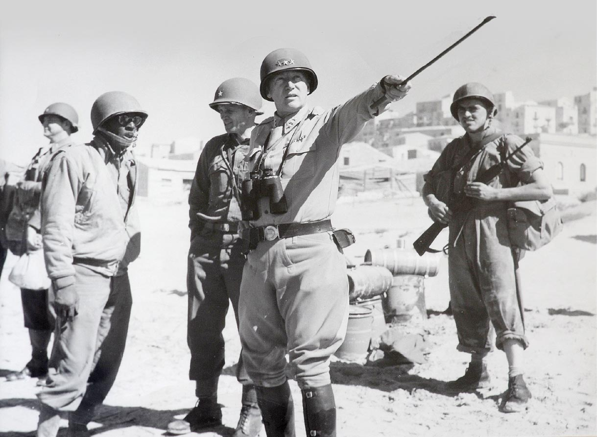 Gen. George S. Patton Jr. provides guidance to subordinate commanders during the military campaign for Sicily in 1943. (Photo courtesy of Foy S. McNaughton, McNaughton Newspapers)
