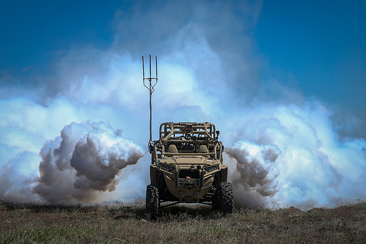 An autonomously activated device emits vapor to obscure the rear of a utility task vehicle 26