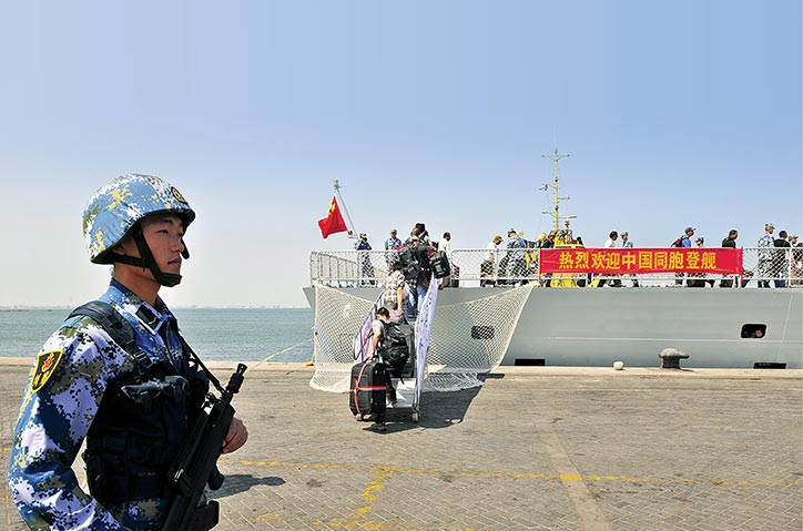 A Chinese soldier of the People's Liberation Army Navy stands guard