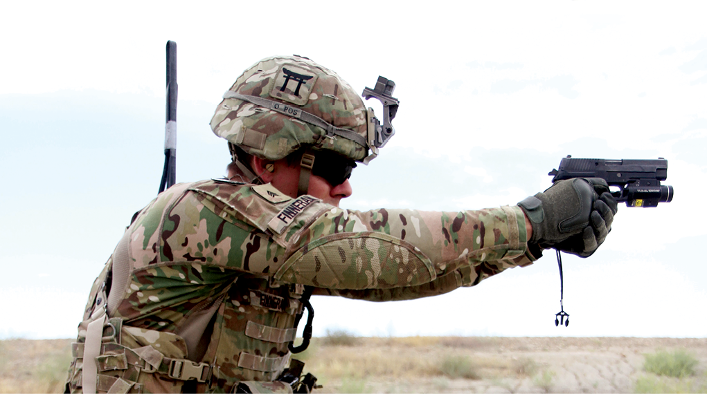 "Sgt. Andrew Finneran, a 101st Airborne Division infantryman, fires a Sig Sauer pistol during partnered weapons training 29 May 2015 at Tactical Base Gamberi in eastern Afghanistan. The Sig Sauer P320 was selected as the replacement for the 9 mm Beretta in 2017. However, many—both in and out of the Army—heavily criticized the acquisition process for the pistol, characterizing it as overly bureaucratic, slow, expensive, and wasteful, and arguing that a much improved capability over the existing standard service pistol already existed ""off the shelf."" (Photo by Capt. Charlie Emmons, U.S. Army)"