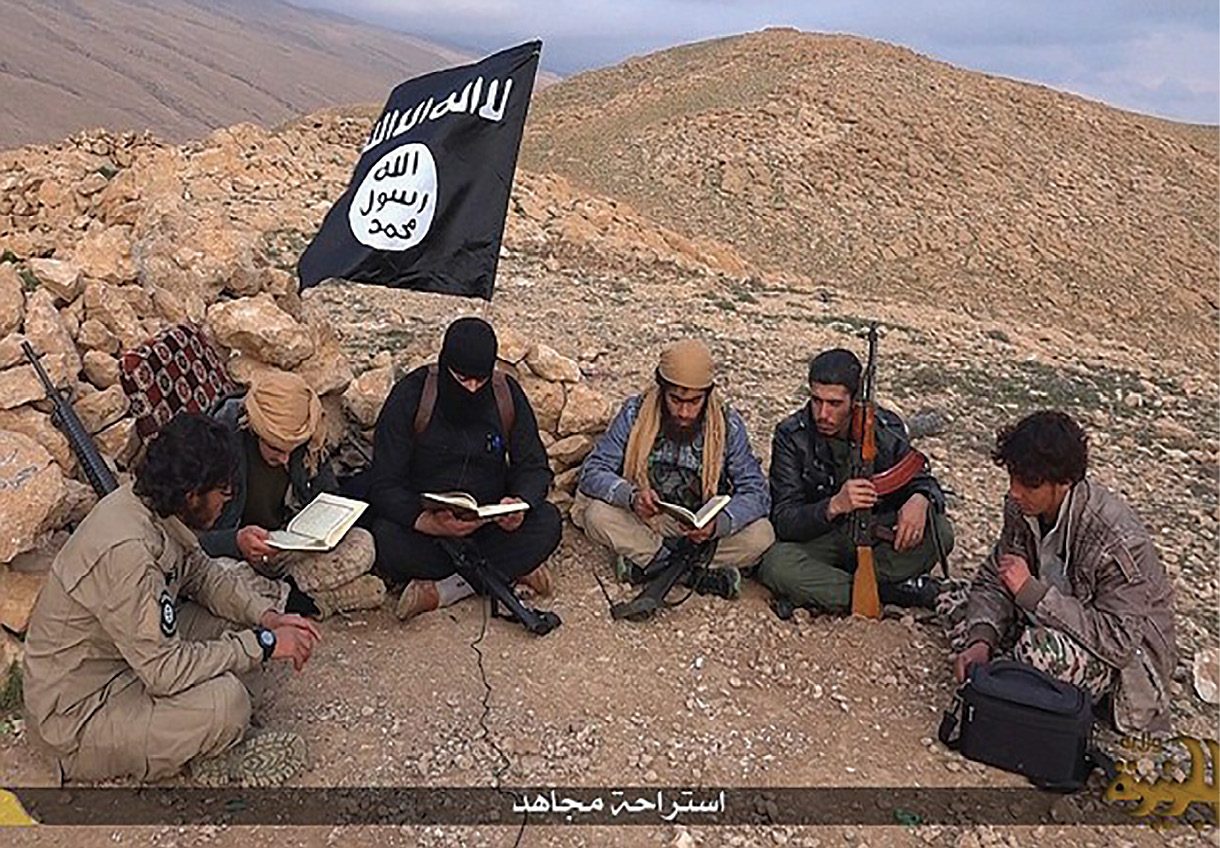 An Islamic State (IS) propaganda video (ca. March 2015) on YouTube reputedly shows fighters studying the Quran at an undisclosed location in Iraq. The fighters are said to be on holiday from a prolonged period of territorial conquest, which included attacks on Yazidis, Kurds, and diverse denominations of Iraqi Christians. The video was subsequently removed. (Screenshot from IS YouTube video)