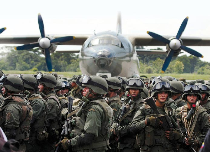 Venezuelan special forces troops deplane from a Venezuelan Air Force Chinese-made Y-8F-100 transport aircraft 1 September 2015 close to the Venezuela-Colombia border in La FrÍa