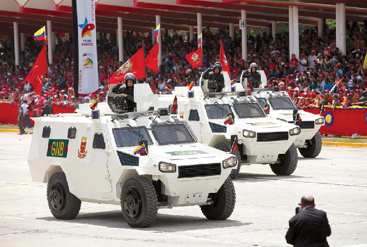 "Venezuela's Chinese-made, light-armored VN-4 ""Rhinoceros"" personnel carriers drive 5 March 2014 in a parade commemorating the death of Hugo Chavez in Caracas"