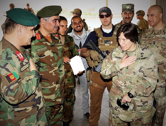 Maj. Gen. Robin Fontes (<em>right</em>), then commander of Combined Security Transition Command-Afghanistan (CSTC-A), meets with Maj. Gen. Monawari (<em>far left</em>), commanding general of Afghan Logistics Command, and Brig. Gen. Fahim (<em>second from left</em>), commander of the Afghan National Army Material Management Center-Afghanistan on 9 August 2017. Fontes is a 1986 graduate of the U.S. Military Academy.