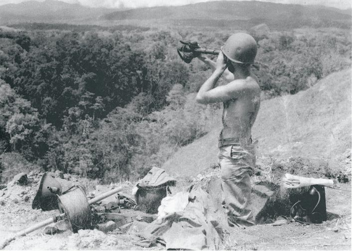 A U.S. Marine guards Hill 80 on Edson's Ridge (also known as Bloody Ridge), Guadalcanal, in 1942.