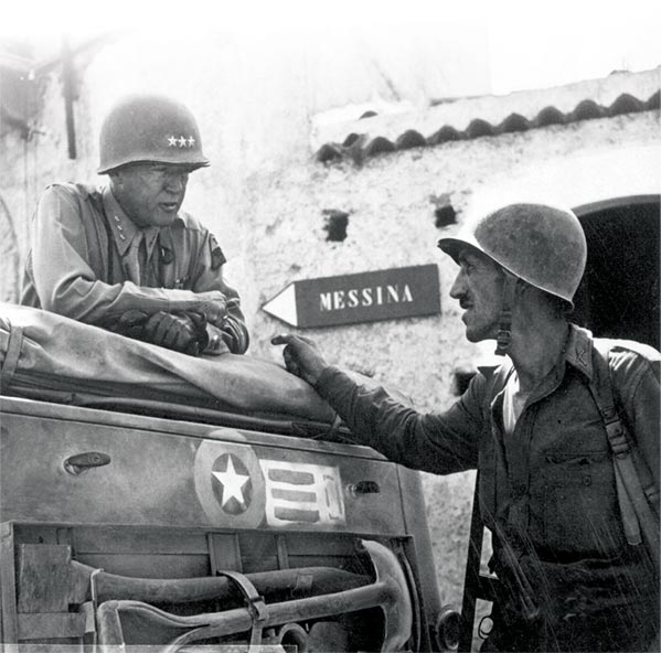 Lt. Col. Lyle Bernard, 30th Infantry Regiment, a prominent figure in the second amphibious landing behind enemy lines on Sicily's north coast, provides a personal update to Lt. Gen. George S. Patton on the ground situation 10 July 1943 near Brolo, Sicily.
