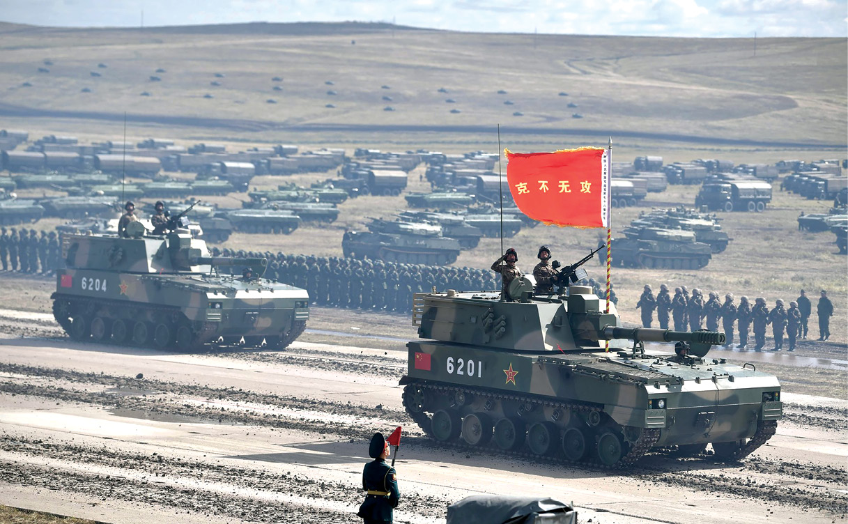 Chinese armored vehicles pass in review September 2018 at the end of the Vostok 2018 military exercise at the Tsugol training ground in Eastern Siberia, Russia.