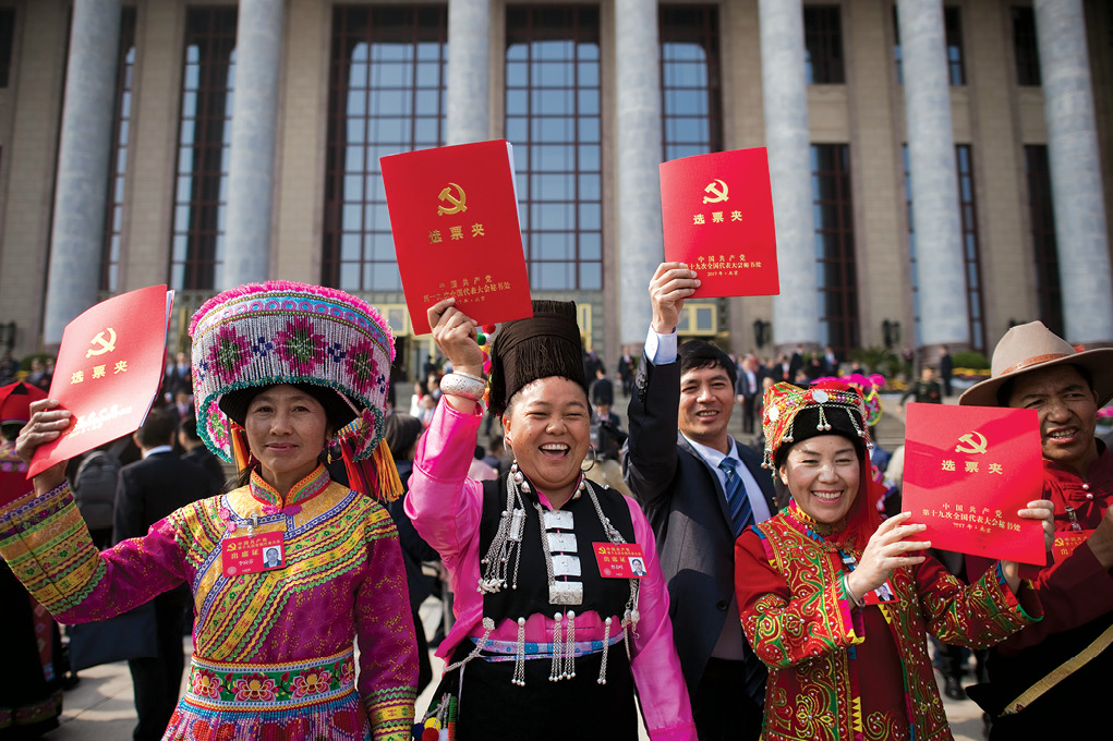 Delegates leave the Great Hall of the People 24 October 2017 after the closing session of the 19th Communist Party Congress in Beijing. President Xi Jinping's name was added to the Communist Party of China's constitution at a defining congress, elevating him alongside Chairman Mao Zedong to the pantheon of the country's founders. (Photo by Nicolas Asfouri, Agence France-Presse)