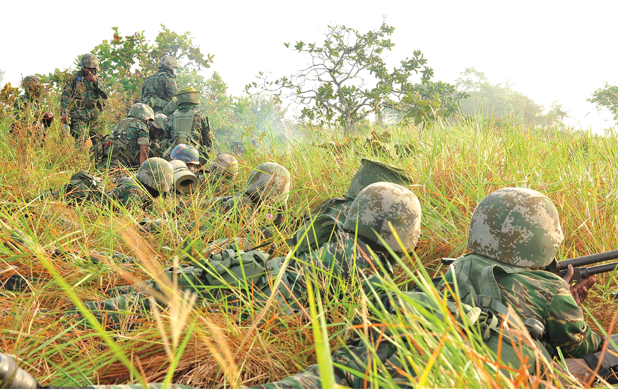 Guyana Defence Force (GDF) soldiers participate in the final attack during Exercise Ironweed in August 2017 at the Colonel John Clarke Military School (CJCMS) at Tacama, Guyana. The exercise is designed to provide an overall assessment of GDF units during simulated combat operations in various types of terrain. (Photo courtesy of the Guyana Defense Force)
