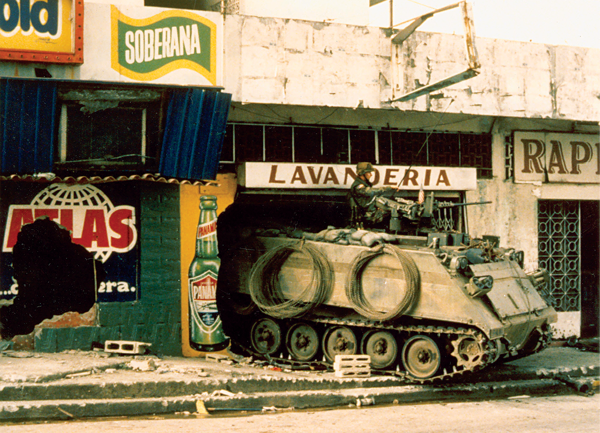 A U.S. M-113 armored personnel carrier finds shelter in a laundromat December 1989 during Operation Just Cause in Panama City. Heavy (armored) forces provided firepower, protection, and mobility during combat and were critical to the success of the operation in Panama's urban terrain. (Photo courtesy of the Maxwell Thurman Photograph Collection at the U.S. Army Center Of Military History)
