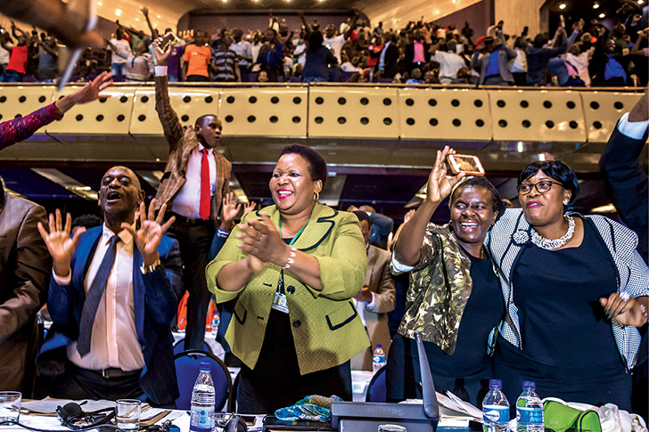 Members of parliament celebrate 21 November 2017 after President Robert Mugabe's resignation in Harare, Zimbabwe. Mugabe was swept from power as his thirty-seven-year reign of brutality and autocratic control crumbled within days of a military takeover. The bombshell news was delivered by the parliament speaker to a special joint session of the assembly that had convened to impeach Mugabe, who had dominated every aspect of Zimbabwean public life since the country's independence in 1980. (Photo by Jekesai Njikizana, Agence France-Presse)