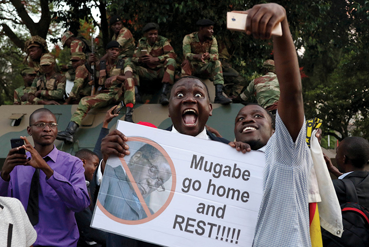 Zimbabweans celebrate 18 November 2017 after President Robert Mugabe resigned in Harare, Zimbabwe.