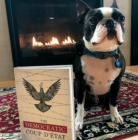 Ozan Varol's beloved pal Einstein poses 22 October 2017 with a copy of The Democratic Coup d'État.
