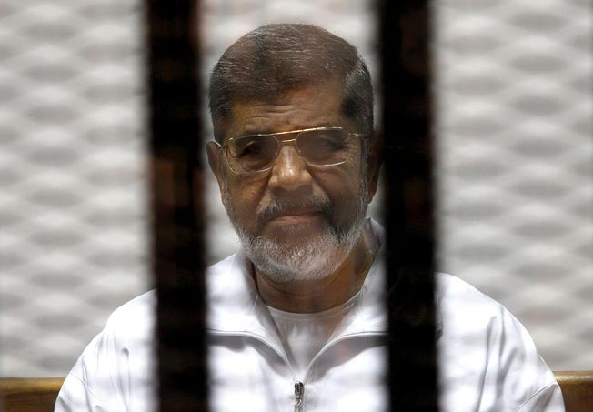 Ousted Islamist Egyptian President Mohamed Morsi is seen behind bars 8 May 2014