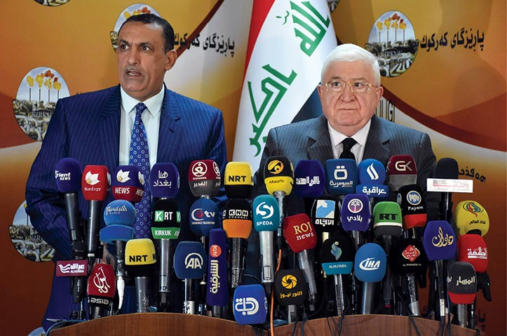 Iraqi President Fuad Masum (<em>right</em>) and Rakan Said al-Juburi, governor of Kirkuk