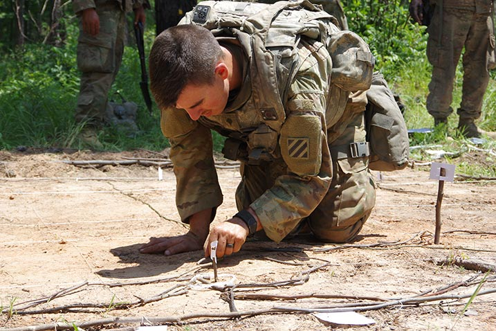 A Georgia National Guard soldier from the 48th Infantry Brigade Combat Team prepares a sand table