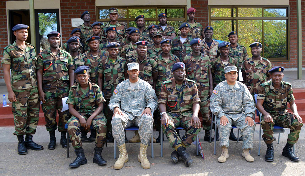 Sgt. Maj. Frederick Blackburn and 1st Lt. Diego Herreno pose with participants in a recent Intelligence Support to Operations seminar in Malawi, Africa. (USARAF photo)