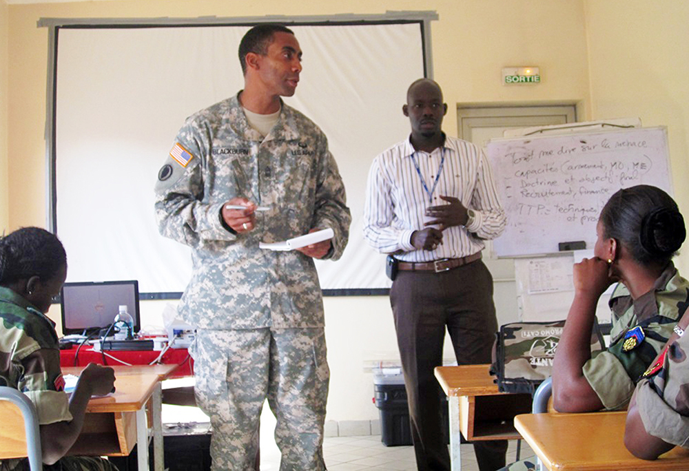 Sgt. Maj. Fredrick Blackburn, U.S. Army Africa's Military Intelligence Training NCOIC, instructs an all – female class during a basic intelligence course in Senegal, Africa. (USARAF photo)