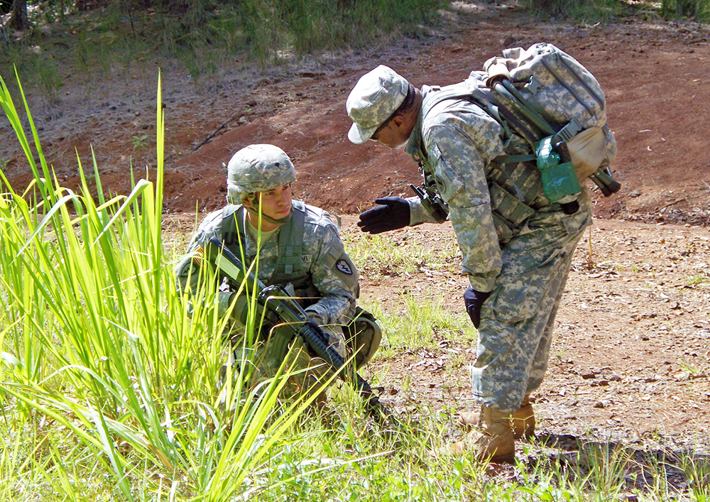 An instructor counsels a student during an exercise at the NCO Academy Hawaii at Schofield Barracks, Hawaii in 2008. (Photo courtesy of U.S. Army Garrison-Hawaii)