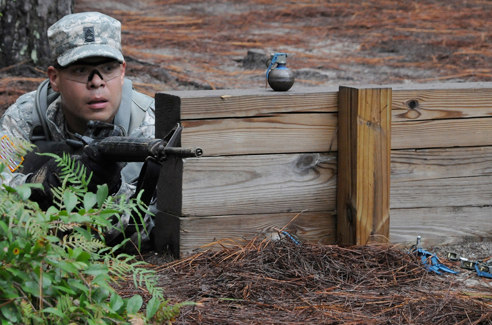 Moreno goes through the hand grenade assault course Monday.