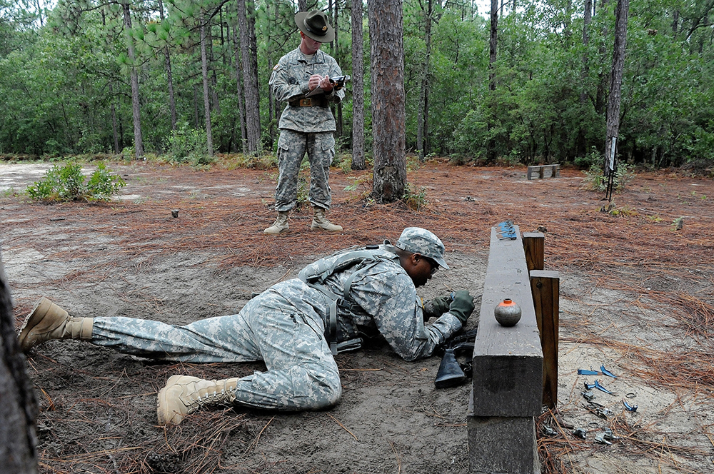 Sgt. 1st Class Kenny Smith of D Company, 16th Ordnance Battalion, at Fort Lee, Va., goes through the hand grenade assault course as a drill sergeant grades him. Smith is competing to be named AIT Platoon Sergeant of the Year. (Photos by Jonathan (Jay) Koester)