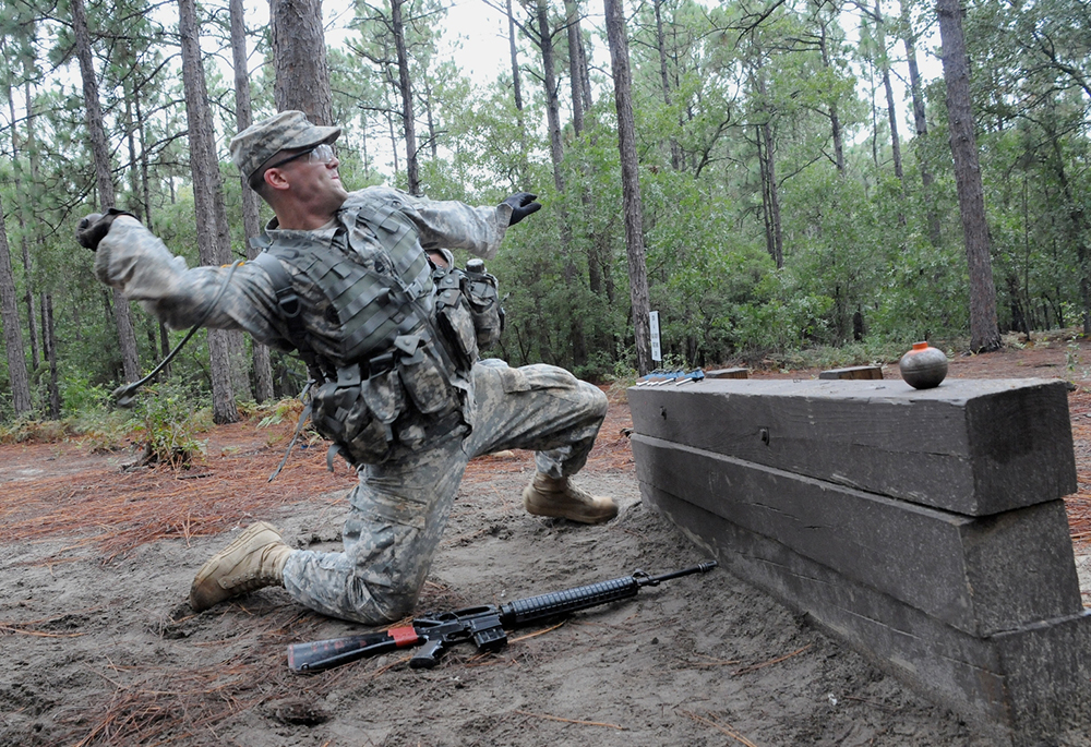 Sgt. 1st Class Alex Montero of the 98th Training Division, U.S. Army Reserve, throws a practice grenade on the hand grenade assault course Monday. Montero is one of two competitors from the 108th Training Command competing for the title of Army Reserve Drill Sergeant of the Year.</p>