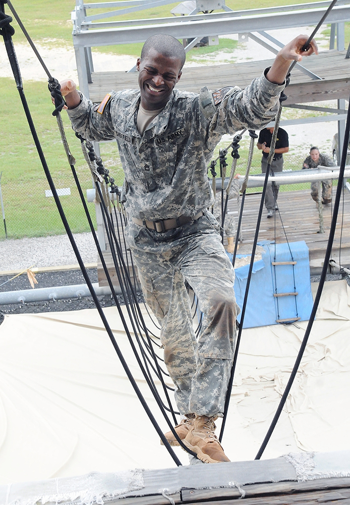 Sheffield grimaces as his legs cramp Monday during a rope climb on the Victory Tower.