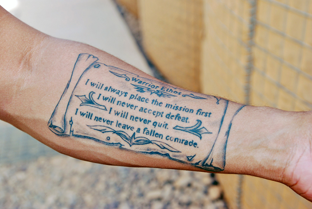 "Since it was done several years ago, 1st Sgt. Aki Paylor's tattoo of the Warrior Ethos is ""grandfathered in"" under the Army's new tattoo guidelines, which took effect earlier this year. (Photo by Staff Sgt. Stephanie van Geete)"
