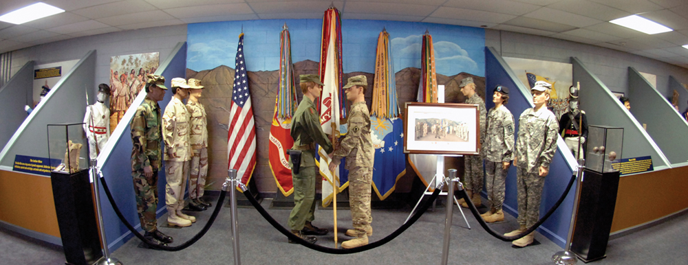 Astrid Owens, an artist and the spouse of a USASMA staffmember, painted murals behind several of the displays. The one above depicts El Paso's own Franklin Mountains, which can be seen from the center's front door.