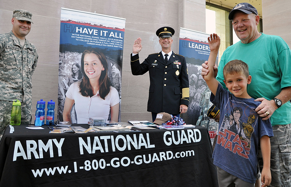 Recruiters from the Virginia National Guard meet with the public in June 2011 outside the Virginia War Memorial in Richmond, Virginia, during a 236th Army Birthday celebration. (Photo by Staff Sgt. Andrew H. Owen)