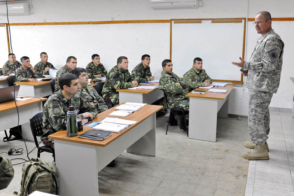Sgt. Maj. Jorge Lopez (right), the sergeant major of U.S. Army South's medical directorate, conducts a presentation to members of the Uruguayan military during a subject-matter expert exchange in September 2014 in Uruguay. (Photo by Robert Ramon)