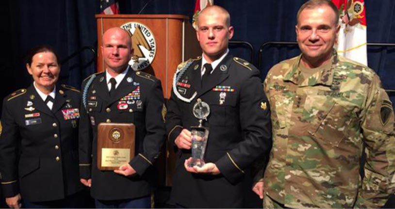 >U.S. Army Europe's command sergeant major, Command Sgt. Maj. Shery Lyon, and commander, Lt. Gen. Ben Hodges (<i>right</i>), congratulate USAREUR's competitors in the Best Warrior Competition, Soldier of the Year