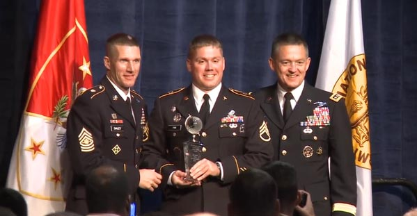 Staff Sgt. Andrew Fink, the 2015 NCO of the Year, accepts his award from Sgt. Maj. of the Army Daniel A. Dailey (<i>left</i>) and Vice Chief of Staff of the Army Gen. Daniel B. Allyn.