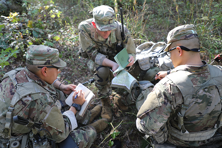 A group of U.S. Army Pre-Ranger Students, looks over the route to the objective on a map during Pre-Ranger School.