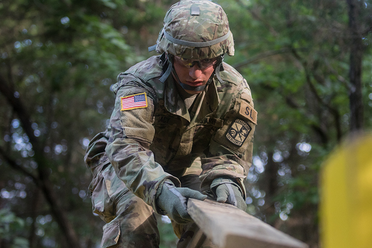 Cadet Jack Lacy, of Texas A&M University, negotiates an obstacle during Field Leadership Reaction Course