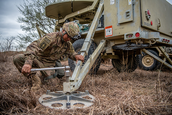 U.S. Army Sgt. Nathan Quitugua, a multichannel transmission systems operator-maintainer assigned to the 2nd Battalion, 18th Field Artillery Regiment, 75th Field Artillery Brigade, sets up a satellite transportable terminal.