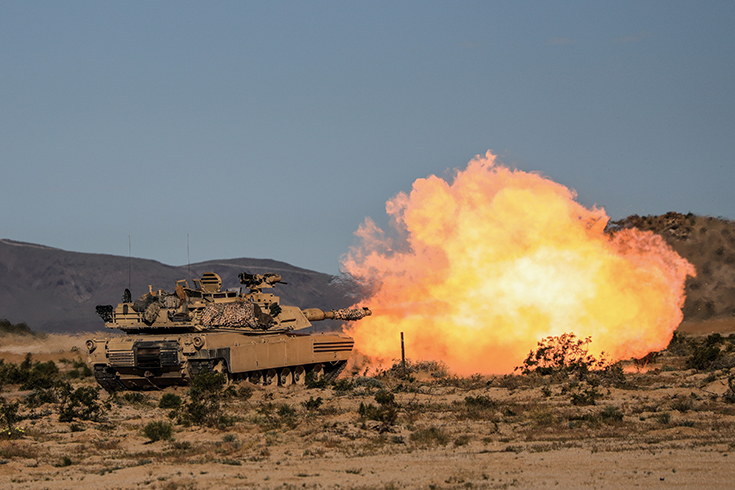 "A U.S. Army M1A2 Abrams assigned to 2nd Armored Brigade Combat team ""Blackjack"", 1st Cavalry Division, Fort Hood, Texas, fires at a simulated target during Decisive Action Rotation 19-06 at the National Training Center (NTC) in Fort Irwin, Calif., April 19, 2019"