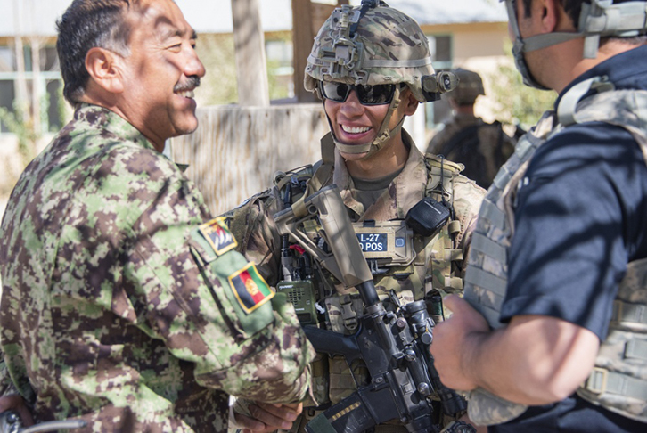 Sgt. 1st Class Jeremiah Velez, center, an advisor with the 1st Security Force Assistance Brigade's 3rd Squadron, interacts with Afghan Command Sgt. Maj. Abdul Rahman Rangakhil