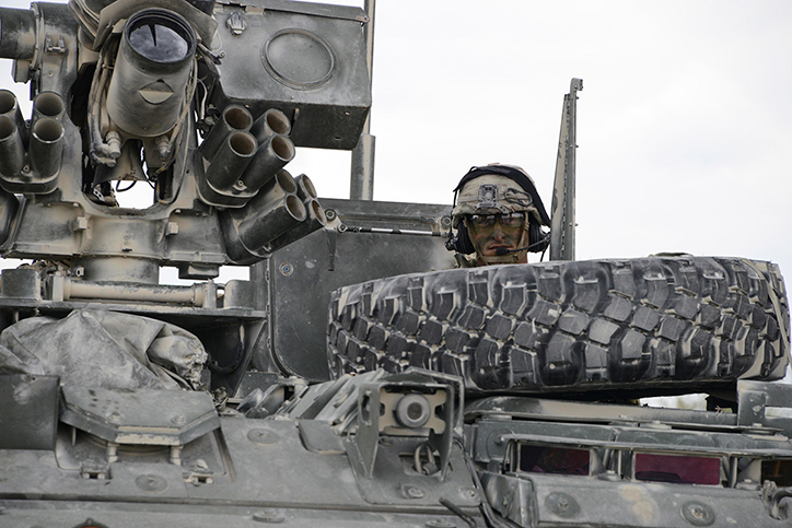 A U.S. Soldier assigned to 2nd Cavalry Regiment waits inside a Stryker armored vehicle