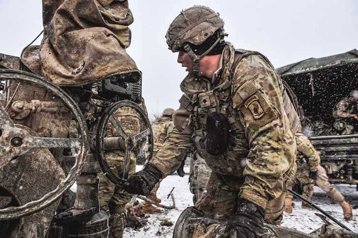Paratroopers assigned to Chaos Battery, 4th Battalion, 319th Field Artillery Regiment, 173rd Airborne Brigade prepare their M777 howitzer
