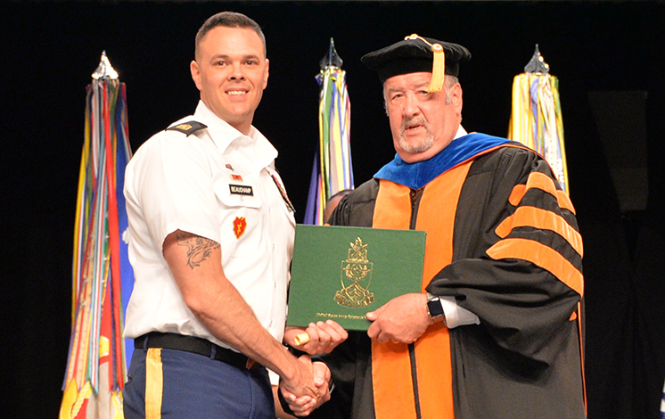 Sgt. Maj. Nicholas Beauchamp receives his Bachelor of Arts degree in Leadership and Workforce Development diploma