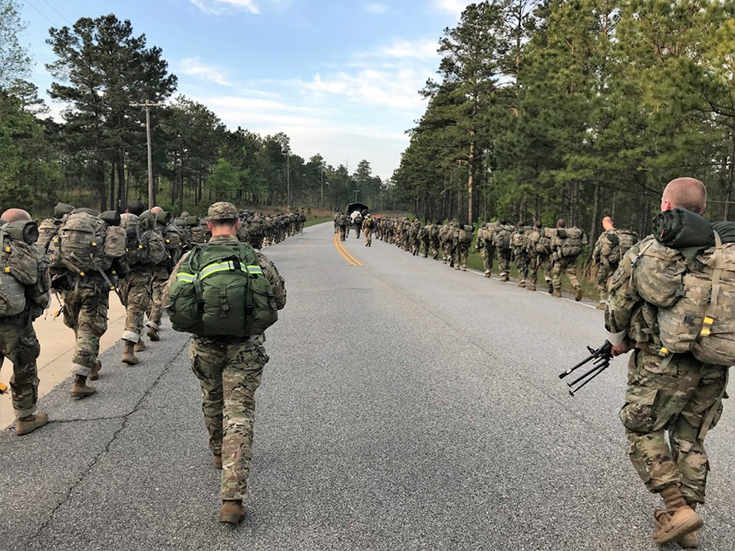 U.S. Army Rangers from 3rd Battalion, 75th Ranger Regiment and the Ranger Recruiting Liaison office participate in a 12-mile ruck march with trainees of infantry
