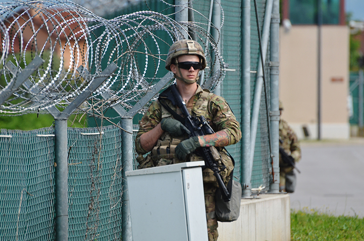 A U.S. Army Soldier patrols the perimeter at the Vicenza Military Community during its full-scale Lion Response 2018 exercise on Caserma Del Din, Italy, May 9, 2018