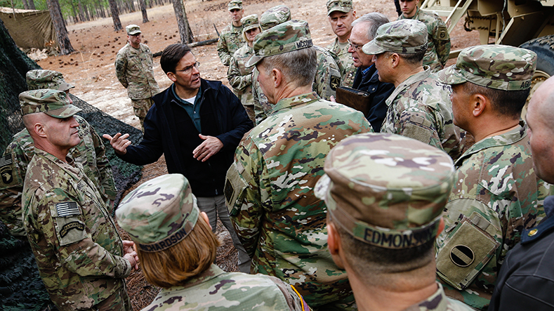 Secretary of the Army Dr. Mark T. Esper discusses the tactical use of military equipment with senior members of the U.S. Army