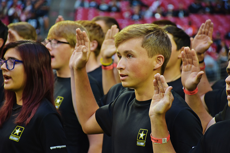 Future Soldiers from the Phoenix Recruiting Battalion, recite the oath of enlistment