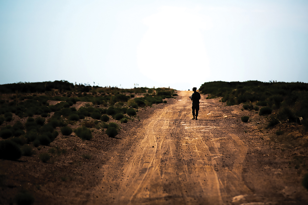 Sgt. Brendan Pinkham, assigned to Headquarters and Headquarters Company, 1st Battalion, 35th Infantry Regiment, 2nd Armored Brigade Combat Team, 1st Armored Division, finishes his last land navigation point June 5 during the new Desert Warrior course at Fort Bliss, Texas. (Photo by Sgt. Marcus Fichtl/U.S. Army)