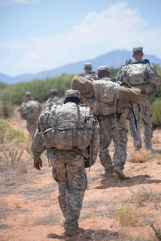 Staff Sgt. Cory Ragin, an instructor for the new Desert Warrior course at Fort Bliss, Texas, rucks behind his squad during a field exercise. (Photo by Meghan Portillo/NCO Journal)