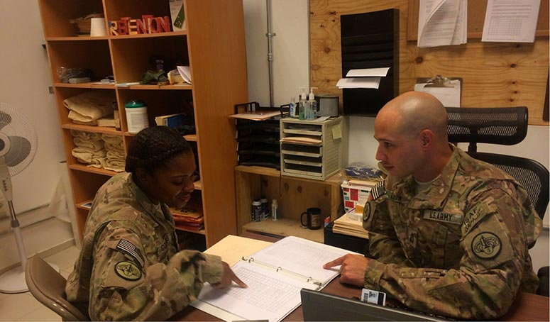 U.S. Army Sgt. 1st Class Pedro Leon (<i>right</i>) provides career advice and counseling to U.S. Army Sgt. Kareena Collins, Aug. 25, 2014.